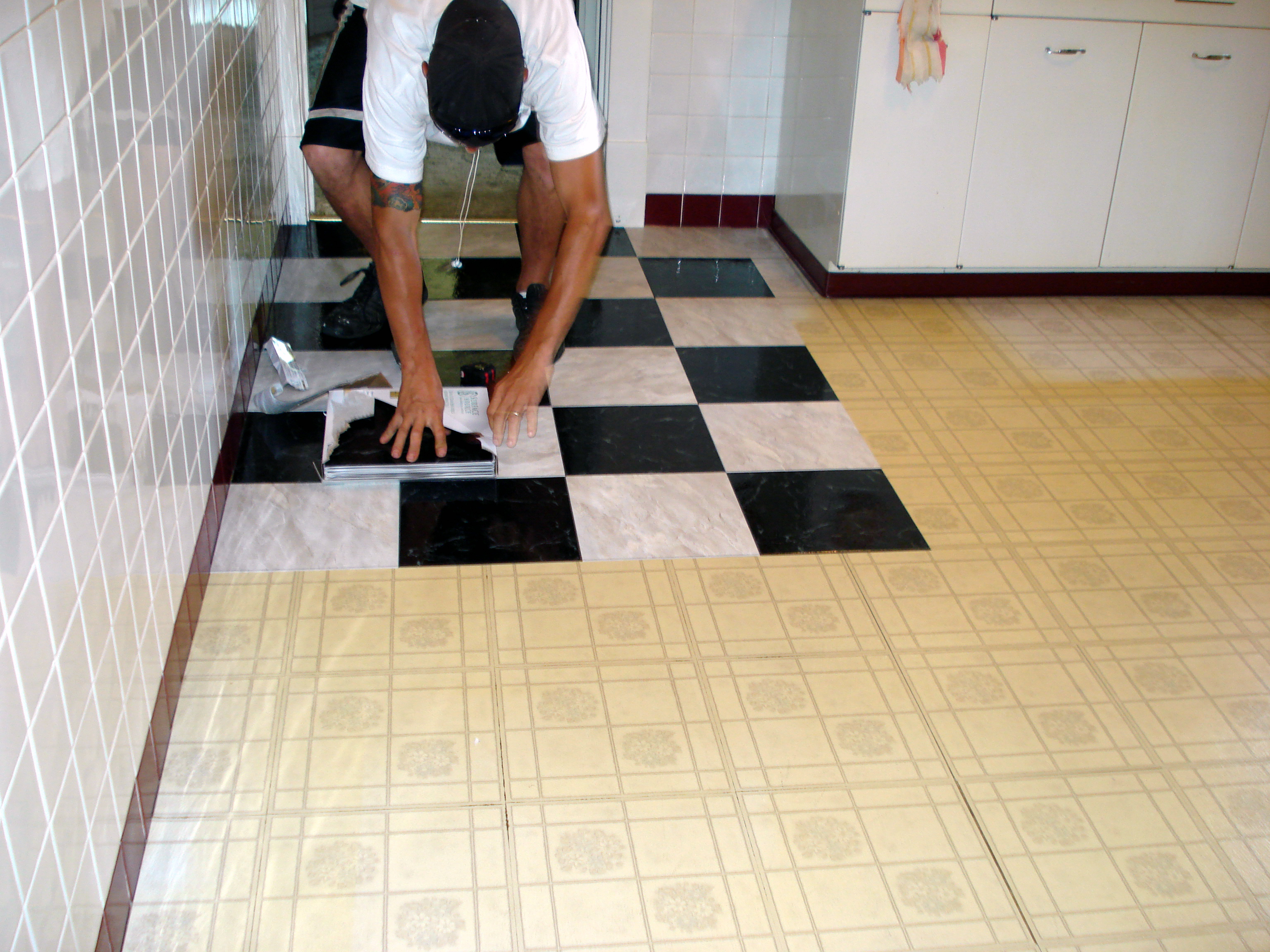 How do you lay floor tiles